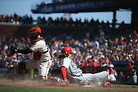 SAN FRANCISCO, CA - JUNE 19:  Alec Bohm #28 of the Philadelphia Phillies slides home safely as San Francisco Giants catcher Buster Posey #28 takes a late throw during the game at Oracle Park on Saturday, June 19, 2021 in San Francisco, California. (Photo by Brad Mangin)