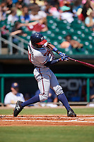 Mississippi Braves second baseman Travis Demeritte (11) follows through on a swing during a game against the Montgomery Biscuits on April 25, 2017 at Montgomery Riverwalk Stadium in Montgomery, Alabama.  Mississippi defeated Montgomery 3-2.  (Mike Janes/Four Seam Images)