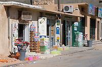 Tarhouna, Libya - Grocery Store Street Scene, Bread, Brooms, Disposable Diapers, Detergent for Sale.