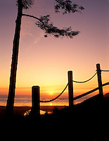Rope fence and setting sun. Near Newport, Oregon