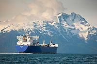 The polar enterprise oil tanker travels north into the valdez arm, Chugach mountains range borders the channel, Prince William Sound, Alaska.