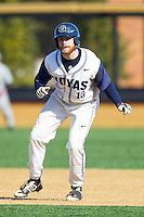 AC Carter (13) of the Georgetown Hoyas takes his lead off of first base against the Marshall Thundering Herd at Wake Forest Baseball Park on February 15, 2014 in Winston-Salem, North Carolina.  The Thundering Herd defeated the Hoyas 5-1.  (Brian Westerholt/Four Seam Images)
