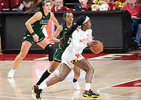 COLLEGE PARK, MD - DECEMBER 8: Kaila Charles #5 of Maryland moves past Alexis Gray #20 of Loyola during a game between Loyola University and University of Maryland at Xfinity Center on December 8, 2019 in College Park, Maryland.