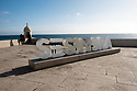 Large letters, spelling out 'SESIMBRA', on the top of the Fortaleza de Santiago, Sesimbra, Portugal.