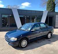 BNPS.co.uk (01202 558833)<br /> Pic: HampsonAuctions/BNPS<br /> <br /> Pictured: 1996 Ford Escort 16v.<br /> <br /> Since the 1990s, Geoff Barlow, 46, has collected dozens of classic cars from an Escort Mexico replica to several types of Transit, Cortina, and Sierra.<br /> <br /> However, he still regrets selling the first car which inspired his passion, a 1980 Escort Mark 2 he bought from his sister in 1992.  <br /> <br /> Geoff's fascination with Fords gathered pace in the last decade and he 'lost control,' buying as many Fords as he came across and saving them from disrepair.