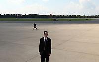 Secret service await the arrival of President Barack Obama at the Charlottesville/Albemarle Airport in Charlottesville, VA.