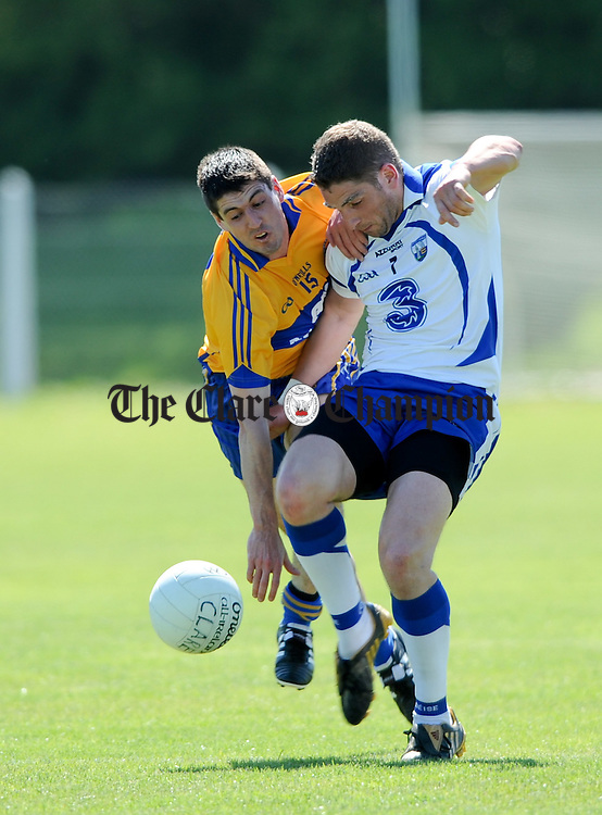 Diarmuid Daly of Clare in action against Eamon Walsh of Waterford during their Munster Senior football championship game at Dungarvan. Photograph by John Kelly.