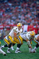 SAN FRANCISCO, CA: Quarterback Brett Favre of the Green Bay Packers drops back to pass during the NFC playoff game against the San Francisco 49ers at Candlestick Park in San Francisco, California on January 6, 1996. (Photo by Brad Mangin)