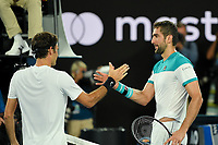 January 28, 2018: Number two seed Roger Federer of Switzerland shakes hands after winning the Men's Final against number six seed Marin Cilic of Croatia on day fourteen of the 2018 Australian Open Grand Slam tennis tournament in Melbourne, Australia. Federer won 3 sets to 2. Photo Sydney Low
