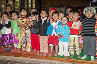 Myanmar, Burma.  Little Burmese Children of Pre-School Age, Intha Ethnic Group, Inle Lake, Shan State.  Some have thanaka paste on their faces, a cosmetic sunscreen.