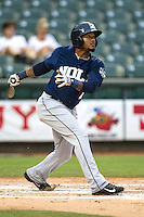 New Orleans Zephyrs second baseman Jordany Valdespin (7) follows through on his swing during the Pacific Coast League baseball game against the Round Rock Express on May 27, 2014 at the Dell Diamond in Round Rock, Texas. The Zephyrs defeated the Express 9-0 in a rain shortened game. (Andrew Woolley/Four Seam Images)
