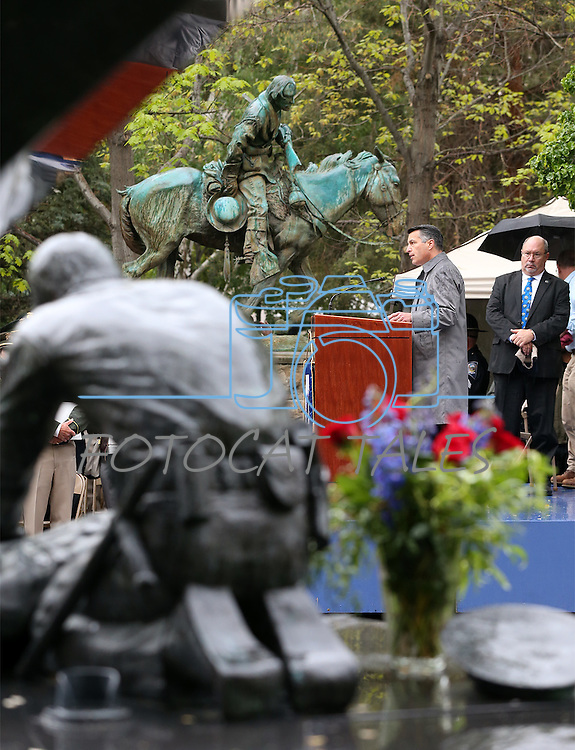 Nevada Gov. Brian Sandoval speaks at the annual Law Enforcement Officers Memorial Ceremony on the Capitol grounds in Carson City, Nev. on Thursday, May 5, 2016. The name of Carson City Sheriff's Deputy Carl Howell was added to the memorial after he was killed in the line of duty in Aug. 2015.<br />Photo by Cathleen Allison/Nevada Photo Source