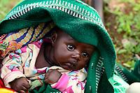 UGANDA, Karamoja, Karamojong Ethnie, village Lokanayona, infant