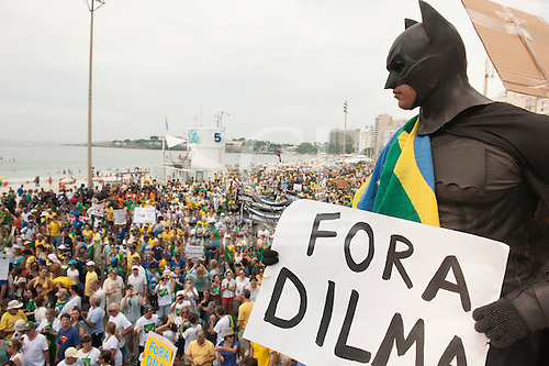 Protestor dressed in a Batman costume with placard saying 'FORA DILMA' (Dilma Out). Rio de Janeiro, Brazil. Demonstration against President Dilma Rousseff.