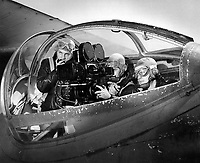 Class 4 students at Naval School of Photography receiving instruction in taking good movies from a PB2Y-4, by V.E. Carberry, PhoM 2/c.