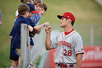 Chattanooga Lookouts Brantley Bell (28) fist bumps a young fan before a Southern League game against the Birmingham Barons on May 2, 2019 at Regions Field in Birmingham, Alabama.  Birmingham defeated Chattanooga 4-2.  (Mike Janes/Four Seam Images)