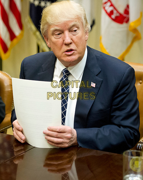 United States President Donald J. Trump makes remarks as he hosts a listening session with the Fraternal Order of Police in the Roosevelt Room of the White House in Washington, DC on Tuesday, March 28, 2017.<br /> CAP/MPI/CNP/RS<br /> ©RS/CNP/MPI/Capital Pictures