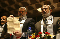 """Palestinian Prime Minister of the Hamas government in Gaza, Ismail Haniyeh, left, and Mahmoud Zahar, right, participate in a parliament meeting discussing Palestinian rights in light of the upcoming U.S.-hosted Annapolis summit, in Gaza City, Monday, Nov. 26, 2007. The Islamic Hamas rulers of Gaza stepped up their verbal attacks on Palestinian President Mahmoud Abbas on Monday ahead of a U.S.-hosted Mideast conference, saying his policies had failed and undermined prospects for Palestinian statehood and unity. """"photo by Fady Adwan"""""""