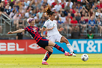 EAST HARTFORD, CT - JULY 5: Megan Rapinoe #15 of the United States battles for the ball with Bianca Sierra #2 of Mexico during a game between Mexico and USWNT at Rentschler Field on July 5, 2021 in East Hartford, Connecticut.