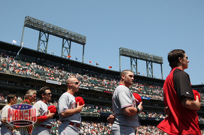 SAN FRANCISCO - AUGUST 9:  Team members of the Cincinnati Reds stand on the field for the National Anthem before the game against the San Francisco Giants at AT&T Park on August 9, 2009 in San Francisco, California. Photo by Brad Mangin