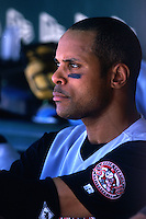 SAN FRANCISCO, CA - Barry Larkin of the Cincinnati Reds sits in the dugout during a game against the San Francisco Giants at Pacific Bell Park in San Francisco, California in 2000. Photo by Brad Mangin