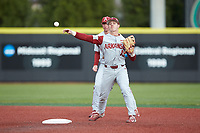 Arkansas Razorbacks second baseman Casey Martin (15) makes a throw to first base to complete a double play during the game against the Charlotte 49ers at Hayes Stadium on March 21, 2018 in Charlotte, North Carolina.  The 49ers defeated the Razorbacks 6-3.  (Brian Westerholt/Four Seam Images)