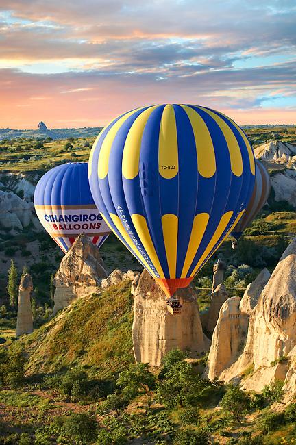 Hot Air Baloons over the Love Valley at sunrise , Cappadocia Turkey