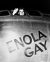 Tinian, West-Pacific<br /> <br /> Col. Paul W. Tibbets, Jr., pilot of the ENOLA GAY, the plane that dropped the atomic bomb on Hiroshima, waves from his cockpit before the takeoff, 6 August 1945. Army Air Forces. (OWI).<br /> <br /> The bombs killed as many as 140,000 people in Hiroshima .n August 15, Japan announced its surrender to the Allied Powers, signing the Instrument of Surrender on September 2, officially ending the Pacific War and therefore World War II.