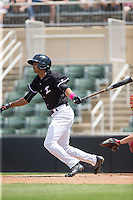 Johan Cruz (27) of the Kannapolis Intimidators follows through on his swing against the Lakewood BlueClaws at Kannapolis Intimidators Stadium on May 8, 2016 in Kannapolis, North Carolina.  The Intimidators defeated the BlueClaws 3-2.  (Brian Westerholt/Four Seam Images)