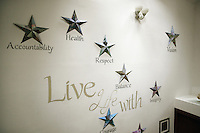 USA. Washington state. Fall City. ReStart Internet Addiction Recovery program at Heavensfield Retreat Center. Mottos on the entrance wall. Silver stars and words. Accountability, health, respect, vision, balance, life,... ReStart is an unique intensive onsite program which offers to participants an opportunity to stay in a retreat center designed to promote insight and renewal, disconnect from digital distractions, and engage in coaching and mentoring while building a blue print for change. The three to six-month reStart program, the first of this kind in the United States, works to help men over 18, suffering from problematic internet, video game, social media and technology use by teaching positive and sustainable lifestyle change in a serene, rural environment surrounded by nature. 10.12.2014 © 2014 Didier Ruef