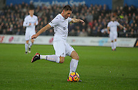Angel Rangel of Swansea City crosses the ball during the Premier League match between Swansea City and Sunderland at The Liberty Stadium, Swansea, Wales, UK. Saturday 10 December 2016