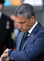 Brighton manager Chris Hughton checks the time during the Premier League match between Swansea City and Brighton and Hove Albion at The Liberty Stadium, Swansea, Wales, UK. Saturday 04 November 2017