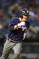 Lehigh Valley IronPigs catcher Andrew Knapp (15) runs to first during a game against the Buffalo Bisons on July 9, 2016 at Coca-Cola Field in Buffalo, New York.  Lehigh Valley defeated Buffalo 9-1 in a rain shortened game.  (Mike Janes/Four Seam Images)