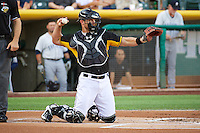 John Hester (22) of the Salt Lake Bees on defense against the Tacoma Rainiers in Pacific Coast League action at Smith's Ballpark on July 8, 2014 in Salt Lake City, Utah.  (Stephen Smith/Four Seam Images)