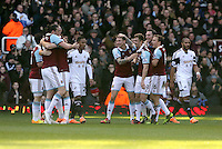 Pictured:  Kevin Nolan of West Ham (C) celebrating his opening goal with team mates. 01 February 2014<br /> Re: Barclay's Premier League, West Ham United v Swansea City FC at Boleyn Ground, London.