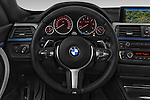 Car pictures of steering wheel view of a 2015 BMW 3 Series M Sport 5 Door Hatchback 2WD Steering Wheel