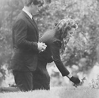 1969 FILE PHOTO - <br /> <br /> Mrs. Ethel Kennedy and son Joseph kneeling beside grave of Senator Robert Kennedy