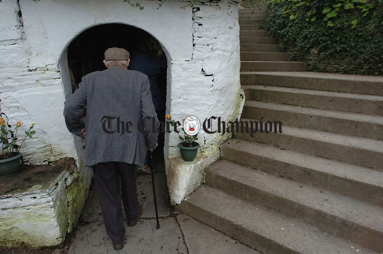 An elderly man enters the grotto at St Brigids Well, Liscannor on the feast day of St Brigid. Photograph by John Kelly.