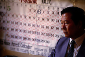 """Seoul, South Korea<br /> June 24, 1987<br /> <br /> Kim Dae-jung, at home with a calender marking his days under house arrest as opposition leader to the ruling party. <br /> <br /> Kim Dae-jung (3 December 1925 to 18 August 2009) was President of South Korea from 1998 to 2003, and the 2000 Nobel Peace Prize recipient. As of this date Kim is the first and only Nobel laureate to hail from Korea. A Roman Catholic since 1957, he has been called the """"Nelson Mandela of Asia"""" for his long-standing opposition to authoritarian rule."""