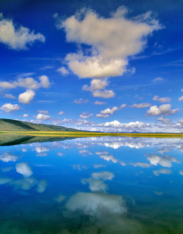 Reflection of clouds on Chickahominy Reservoir, Oregon.