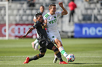 LOS ANGELES, CA - APRIL 17: Matt Besler #5 of Austin FC battles with Latif Blessing #7 of LAFC during a game between Austin FC and Los Angeles FC at Banc of California Stadium on April 17, 2021 in Los Angeles, California.