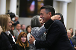 Gov. Brian Sandoval hugs his mother Teri before unveiling his official portrait during a ceremony at the Capitol in Carson City, Nev., on Thursday, Oct. 25, 2018. <br /> Photo by Cathleen Allison/Nevada Momentum