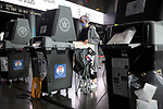 BROOKLYN, NY — OCTOBER 24, 2020:  A person wearing a face mask scans their ballots inside the Barclay's Center, during the first day of early voting in the U.S. Presidential Election, on October 24, 2020 in Brooklyn, NY.  Photograph by Michael Nagle