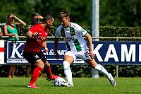 LEEK - Voetbal, Pelikaan S - FC Groningen , voorbereiding seizoen 2021-2022, oefenduel, 03-07-2021,  FC Groningen speler Kian Slor in duel met Shkodran Metaj