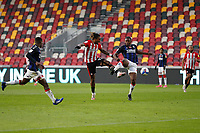 7th November 2020; Brentford Community Stadium, London, England; English Football League Championship Football, Brentford FC versus Middlesbrough; Ivan Toney of Brentford being challenged by Anfernee Dijksteel of Middlesbrough