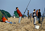 Sea anglers cast out their lines Stokes Bay Near Gosport Hampshire. 1990s