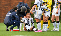 Madison Hudson (8) of Sporting Charleroi injured on the ground being attended by medical staff during a female soccer game between Sporting Charleroi and KRC Genk on the 4 th matchday in play off 2 of the 2020 - 2021 season of Belgian Scooore Womens Super League , friday 30 th of April 2021  in Marcinelle , Belgium . PHOTO SPORTPIX.BE | SPP | Jill Delsaux