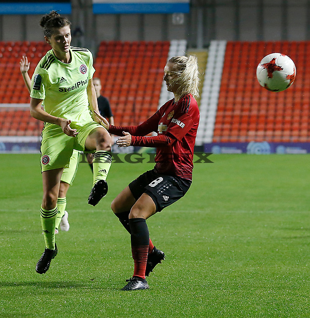Mollie Green of Manchester United Women is passed by Danielle Cox of Sheffield Utd Women