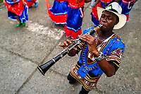 An Afro-Colombian clarinet player of the Pandeyuca neighborhood performs during the San Pacho festival in Quibdó, Colombia, 29 September 2019. Every year at the turn of September and October, the capital of the Pacific region of Chocó holds the celebrations in honor of Saint Francis of Assisi (locally named as San Pacho), recognized as Intangible Cultural Heritage by UNESCO. Each day carnival groups, wearing bright colorful costumes and representing each neighborhood, dance throughout the city, supported by brass bands playing live music. The festival culminates in a traditional boat ride on the Atrato River, followed by massive religious processions, which accent the pillars of Afro-Colombian's identity – the Catholic devotion grown from African roots.
