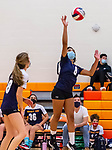 PLYMOUTH, CT-111020JS11 —Wolcott Tech's Yennifer Sarmiento (8)  spikes the ball over the net while teammate Zoe Orie (18) looks on during their match against Terryville Tuesday at Terryville High School. <br /> Jim Shannon Republican-American